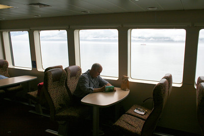 On the ferry. Randy working on the sudoku book I bought him in the airport.